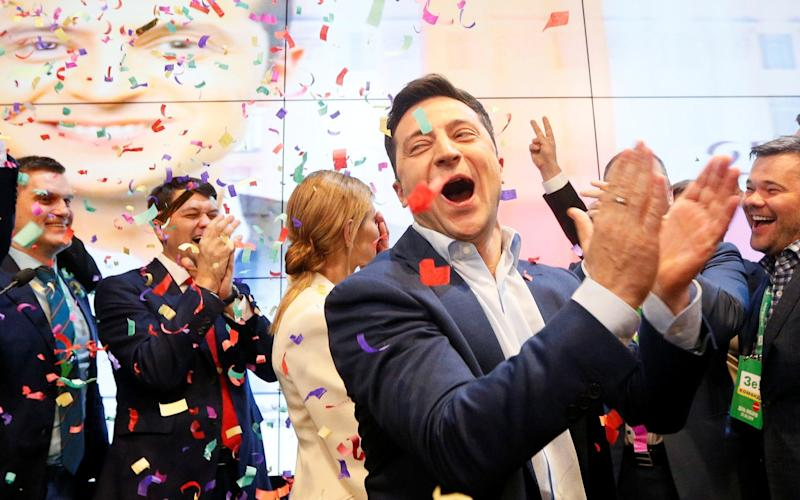 Actor Volodymyr Zelenskiy, who plays Ukraine's president in a hit TV show, celebrates after exit polls showed he has won the post in real life - REUTERS