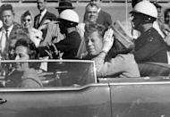 President John F. Kennedy waves from his car in a motorcade approximately one minute before he was shot in Dallas on Nov. 22, 1963. Riding with Kennedy are First Lady Jacqueline Kennedy, right, Nellie Connally, second from left, and her husband, Texas Gov. John Connally, far left. (Photo: Jim Altgens/AP)