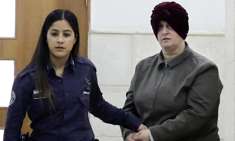 Malka Leifer in handcuffs led by an officer