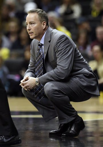 Texas A&M head coach Billy Kennedy watches the action in the first half of an NCAA college basketball game against Vanderbilt on Saturday, Feb. 16, 2013, in Nashville, Tenn. (AP Photo/Mark Humphrey)