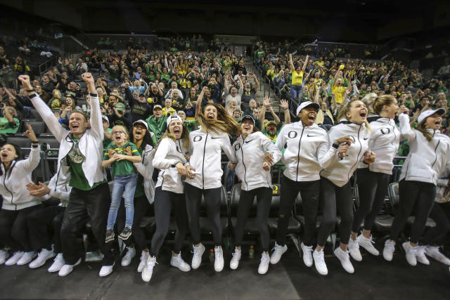 Oregon players react at a watch party in Matthew Knight Arena in Eugene, Oreg., Monday, March 12, 2018, as Oregon is announced as the No. 2 seed in the NCAA Spokane Regional college basketball tournament. Oregon will face Seattle at the arena Friday. (Brian Davies/The Register-Guard via AP)