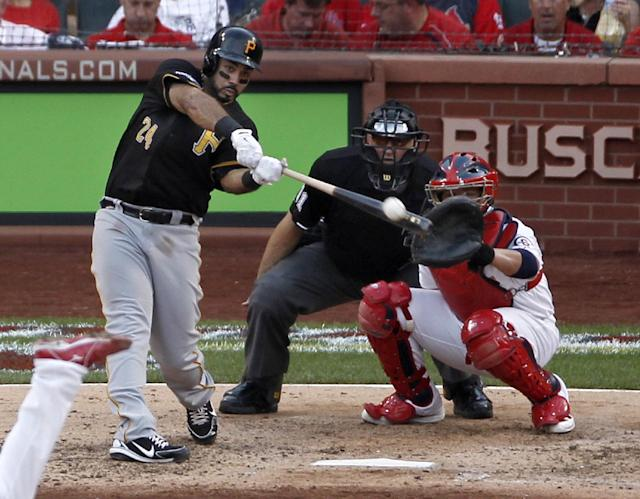 Pittsburgh Pirates' Pedro Alvarez (24) hits a solo home run against the St. Louis Cardinals in the fifth inning of Game 1 of baseball's National League division series on Thursday, Oct. 3, 2013, in St. Louis. Catching for the Cardinals is Yadier Molina. (AP Photo/Sarah Conard)