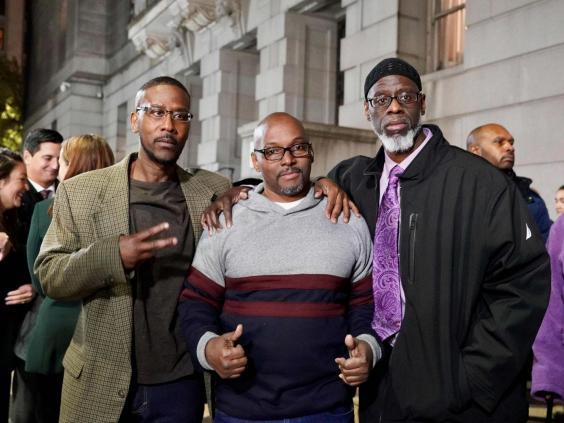 (L-R) Alfred Chesnut, Andrew Stewart and Ransom Watkins pose for a photo after being released from prison in Baltimore, Maryland, US, on 25 November 2019 after serving 36 years for a murder they did not commit. (Mid-Atlantic Innocence Pro/AFP via Getty Images)