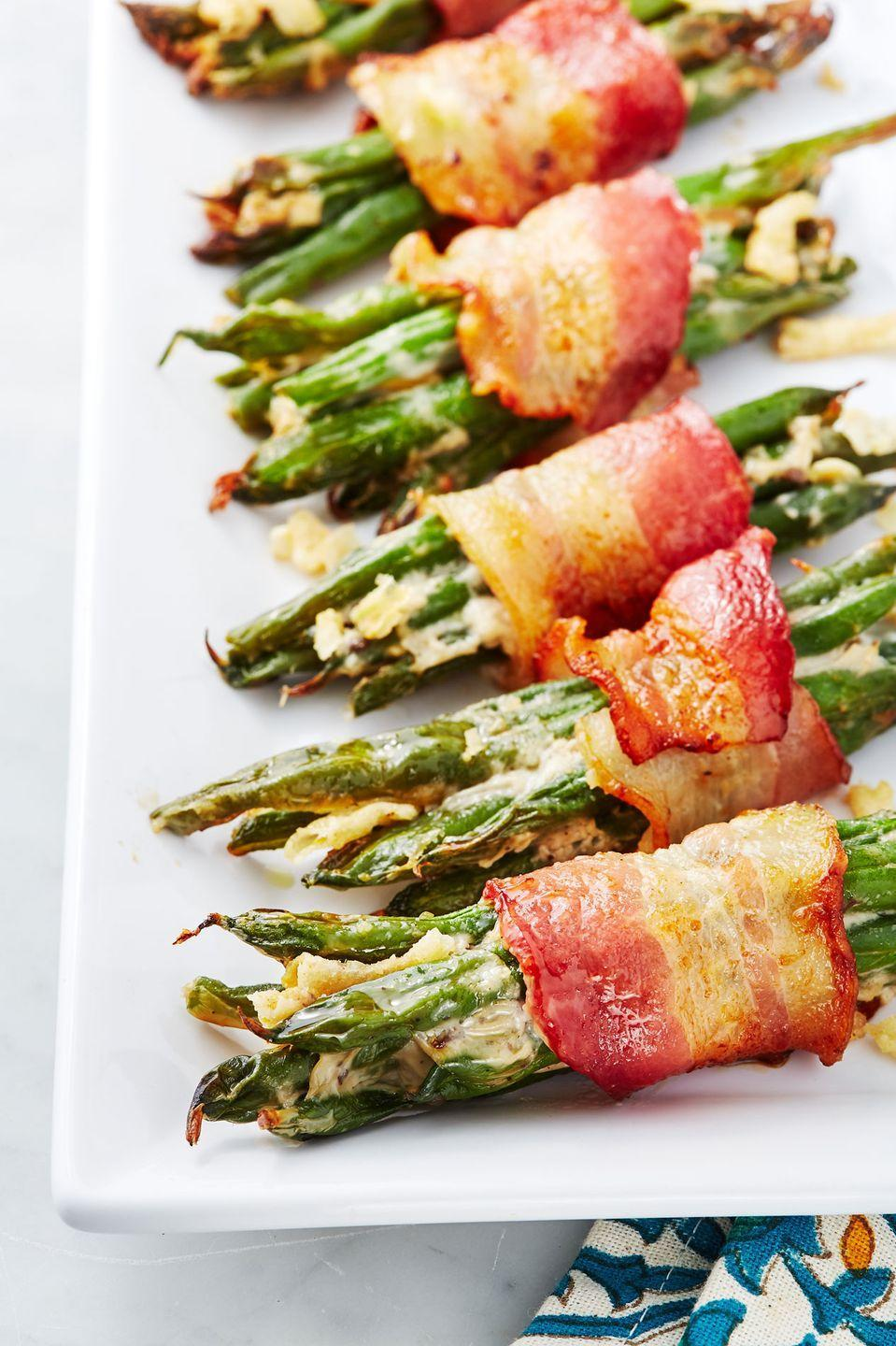 """<p>No need to worry about giving each guest and equal scoop.</p><p>Get the recipe from <a href=""""https://www.delish.com/cooking/recipe-ideas/recipes/a50049/green-bean-casserole-bundles-recipe/"""" rel=""""nofollow noopener"""" target=""""_blank"""" data-ylk=""""slk:Delish"""" class=""""link rapid-noclick-resp"""">Delish</a>.</p>"""