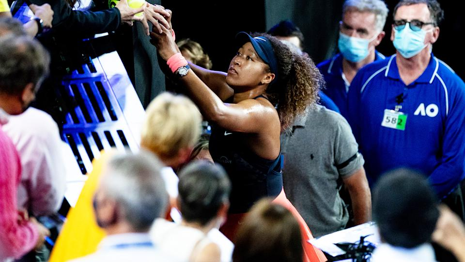 Naomi Osaka, pictured here signing autographs after her victory in the Australian Open final.
