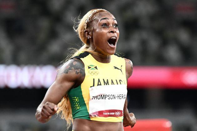 Jamaica's Elaine Thompson-Herah celebrates after her second straight Olympic 100-meter victory. (Photo: JEWEL SAMAD via Getty Images)