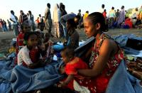 FILE PHOTO: Ethiopian women who fled the ongoing fighting in Tigray region, gather in Hamdayet village near the Setit river on the Sudan-Ethiopia border in eastern Kassala state