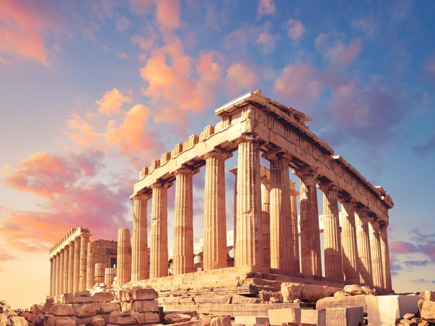 Parthenon temple on a sunset with pink and purple clouds. Acropolis in Athens, Greece - Image