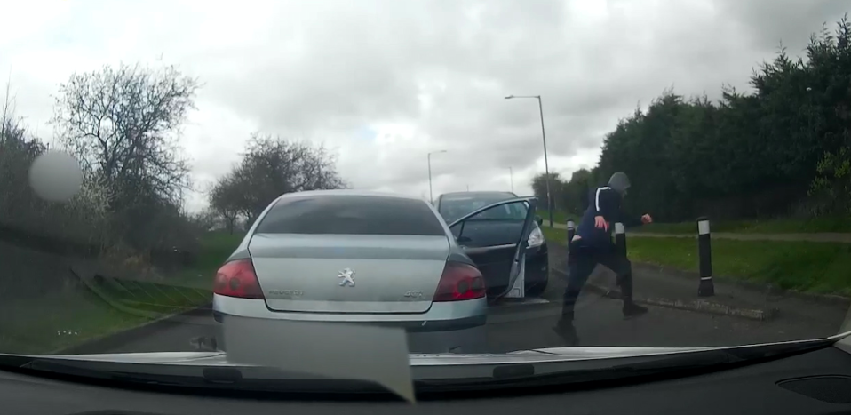 Footage shows Callum Taylor leap out of the car and attempt to flee on foot before being arrested a short distance away. (SWNS)