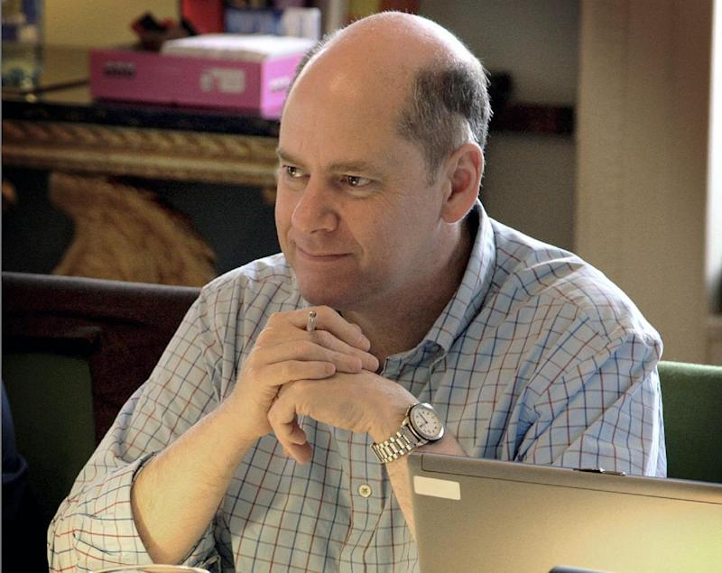 """FILE - In this image file photo dated Tuesday Jan. 6, 2009, provided by the British Government showing The Director General of Britain's domestic spy agency MI5, Jonathan Evans as he sits at a desk in Thames House, London.  Evans is to step down as head of Britain's domestic spy agency MI5 next month, is is announced Monday March 25, 2013.  Evans has led MI5 as Director General since 2007, and Britain's Home Secretary Theresa May announced to lawmakers Monday that the spy chief would be """"moving on"""" after 33-years in the security services.  (AP Photo / British Government - CROWN COPYRIGHT) EDITORIAL USE ONLY"""