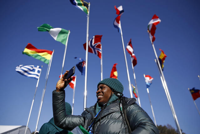 <p>Simidele Adeagbo of the Nigerian Olympic Team snaps a photo before participating in a welcome ceremony inside the PyeongChang Olympic Village prior to the 2018 Winter Olympics. (AP) </p>