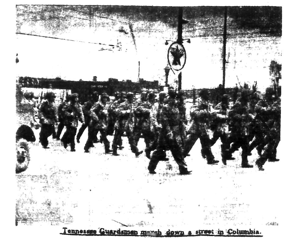 This image published in The Daily Herald on Thursday, Feb. 28, 1946 shows group of Tennessee guardsmen marching through downtown Columbia.