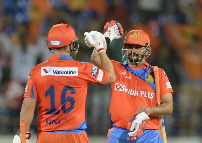 <p>Gujarat Lions cricketer Suresh Raina (R) celebrates with Aaron Finch after winning the 2017 Indian Premier League (IPL) Twenty20 cricket match against Rising Pune Supergiant at the Saurashtra Cricket Association Stadium in Rajkot on April 14, 2017. / AFP PHOTO / PUNIT PARANJPE / —-IMAGE RESTRICTED TO EDITORIAL USE – STRICTLY NO COMMERCIAL USE—– GETTYOUT </p>