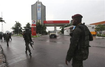 Congolese security forces secure the street near the state television headquarters in the capital Kinshasa, December 30, 2013. REUTERS/Jean Robert N'Kengo