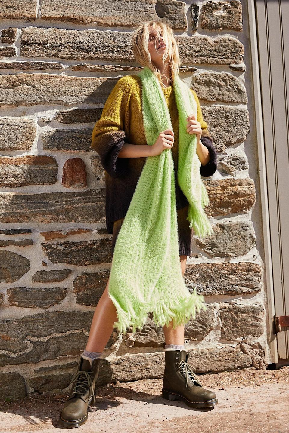 """<p>Chilly days require this <a href=""""https://www.popsugar.com/buy/Whisper-Fringe-Blanket-Scarf-527149?p_name=Whisper%20Fringe%20Blanket%20Scarf&retailer=freepeople.com&pid=527149&price=48&evar1=fab%3Aus&evar9=45460327&evar98=https%3A%2F%2Fwww.popsugar.com%2Ffashion%2Fphoto-gallery%2F45460327%2Fimage%2F46977999%2FWhisper-Fringe-Blanket-Scarf&list1=shopping%2Cgifts%2Cfree%20people%2Choliday%2Cgift%20guide%2Cgifts%20for%20women&prop13=api&pdata=1"""" class=""""link rapid-noclick-resp"""" rel=""""nofollow noopener"""" target=""""_blank"""" data-ylk=""""slk:Whisper Fringe Blanket Scarf"""">Whisper Fringe Blanket Scarf</a> ($48).</p>"""