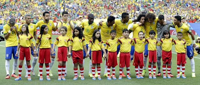 The Brazil team react after singing their national anthem before the group A World Cup soccer match between Brazil and Mexico at the Arena Castelao in Fortaleza, Brazil, Tuesday, June 17, 2014. (AP Photo/Andre Penner)