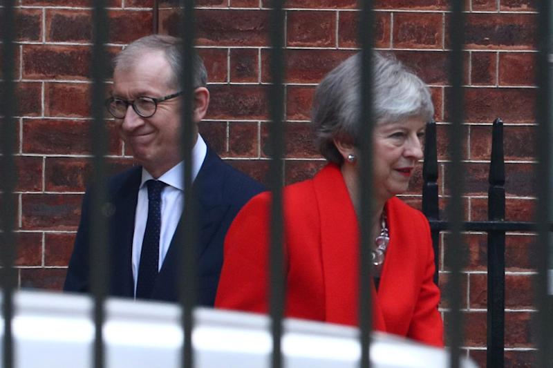Theresa May and her husband Philip yesterday (Reuters)