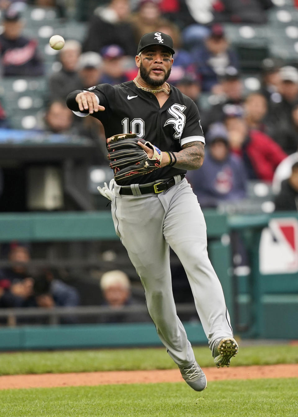 Chicago White Sox's Yoan Moncada throws out Cleveland Indians' Austin Hedges in the fifth inning in the first baseball game of a doubleheader, Thursday, Sept. 23, 2021, in Cleveland. (AP Photo/Tony Dejak)