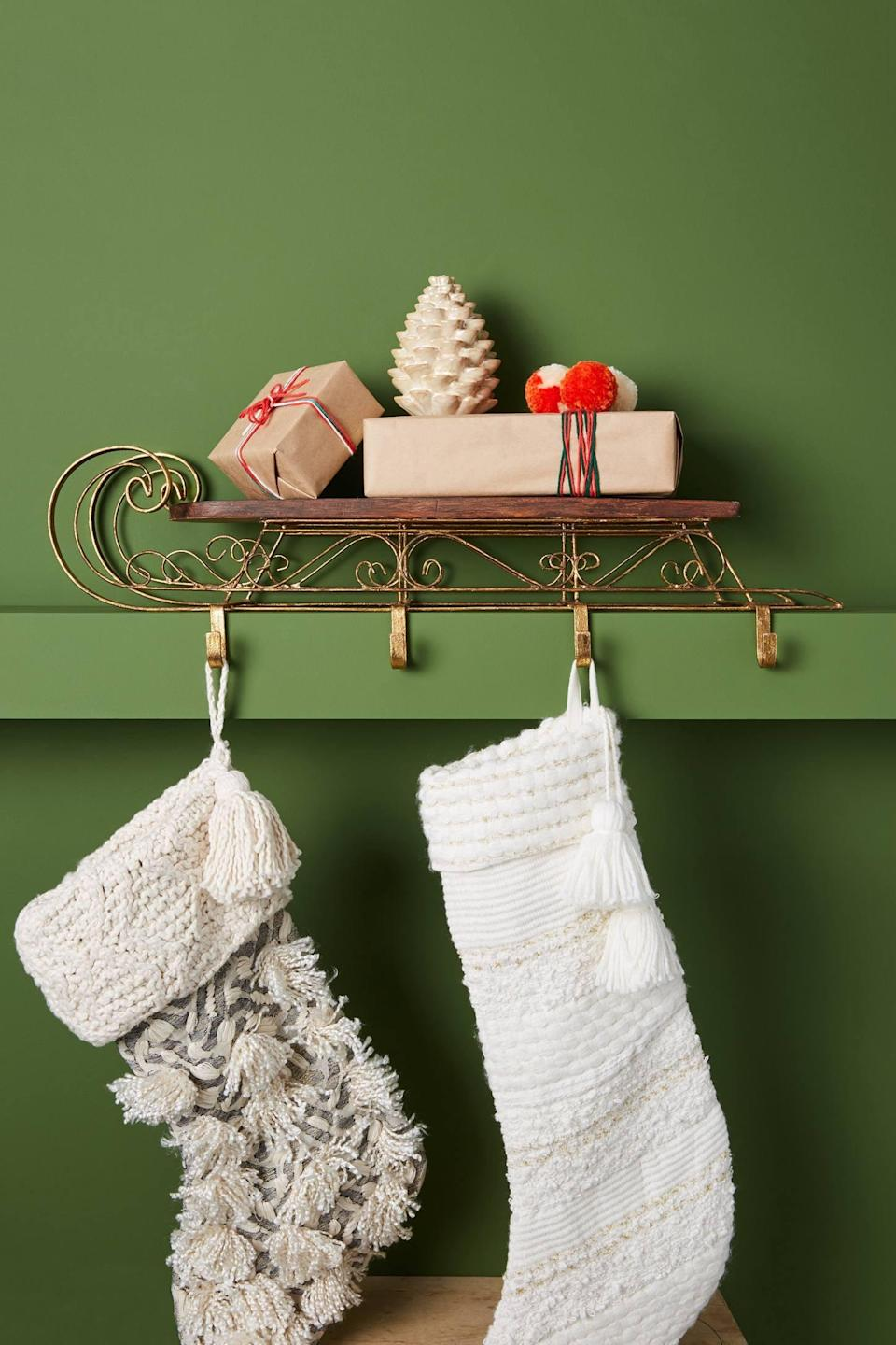 """<p>Display your stockings on this old world-looking <a href=""""https://www.popsugar.com/buy/Wooden-Sleigh-Stocking-Holder-490470?p_name=Wooden%20Sleigh%20Stocking%20Holder&retailer=anthropologie.com&pid=490470&price=158&evar1=casa%3Aus&evar9=46615300&evar98=https%3A%2F%2Fwww.popsugar.com%2Fhome%2Fphoto-gallery%2F46615300%2Fimage%2F46615340%2FWooden-Sleigh-Stocking-Holder&list1=shopping%2Canthropologie%2Choliday%2Cchristmas%2Cchristmas%20decorations%2Choliday%20decor%2Chome%20shopping&prop13=mobile&pdata=1"""" rel=""""nofollow noopener"""" class=""""link rapid-noclick-resp"""" target=""""_blank"""" data-ylk=""""slk:Wooden Sleigh Stocking Holder"""">Wooden Sleigh Stocking Holder</a> ($158).</p>"""