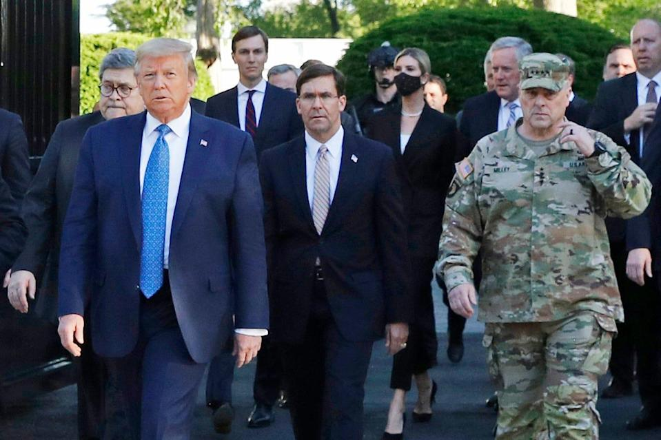 """President Donald Trump departs the White House to visit outside St. John's Church, in Washington on June 1, 2020. Part of the church was set on fire during protests on Sunday night. Walking behind Trump from left are, Attorney General William Barr, Secretary of Defense Mark Esper and Gen. Mark Milley, chairman of the Joint Chiefs of Staff.  Milley says his presence """"created a perception of the military involved in domestic politics."""" He called it """"a mistake"""" that he has learned from."""