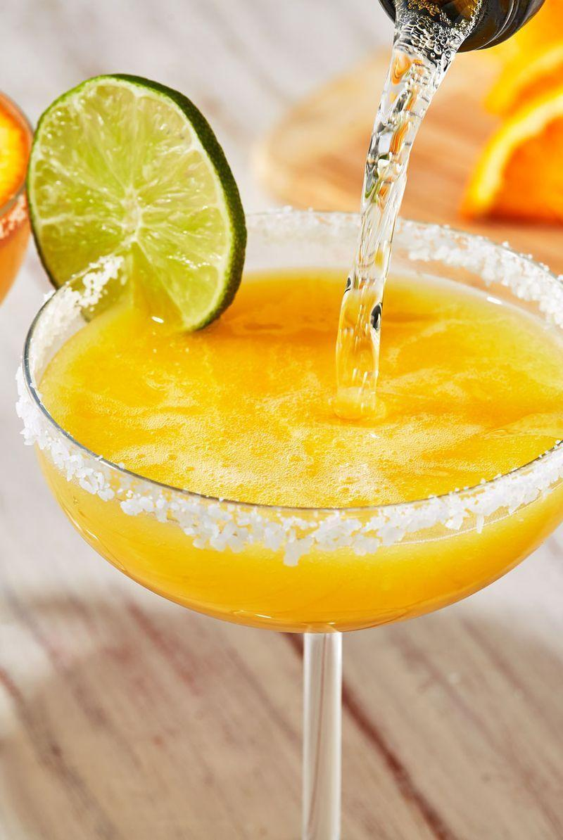 "<p>Mimosa Margaritas are the best combos between the two cocktails. Orange juice and champagne spiked with tequila and some juice for extra zest! </p><p>Get the <a href=""https://www.delish.com/uk/cocktails-drinks/a32233202/mimosa-margaritas-recipe/"" rel=""nofollow noopener"" target=""_blank"" data-ylk=""slk:Mimosa Margaritas"" class=""link rapid-noclick-resp"">Mimosa Margaritas</a> recipe.</p>"