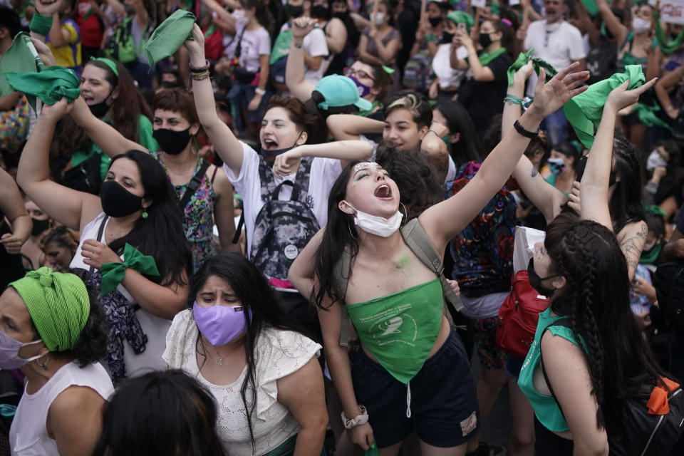 FILE - In this Dec. 11, 2020 file photo, abortion-rights activists gather outside Congress in Buenos Aires, Argentina, amid the new coronavirus pandemic. Large gatherings of people that defied social distancing guidance may have helped spread the virus at the end of 2020. (AP Photo/Victor R. Caivano, File)