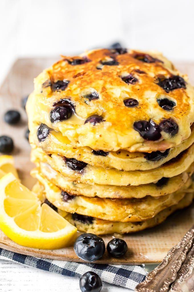 """<p>Every last bite of these pancakes is bursting with fresh fruity flavor.</p><p><strong>Get the recipe at <a href=""""https://www.thecookierookie.com/best-blueberry-pancakes-with-lemon-sauce/"""" rel=""""nofollow noopener"""" target=""""_blank"""" data-ylk=""""slk:The Cookie Rookie"""" class=""""link rapid-noclick-resp"""">The Cookie Rookie</a>.</strong></p>"""