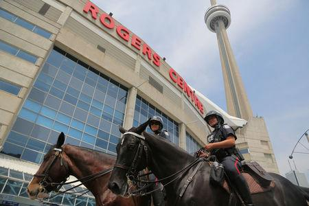 Officers from the Toronto Police Service Mounted Unit are deployed at the Rogers Centre in Toronto