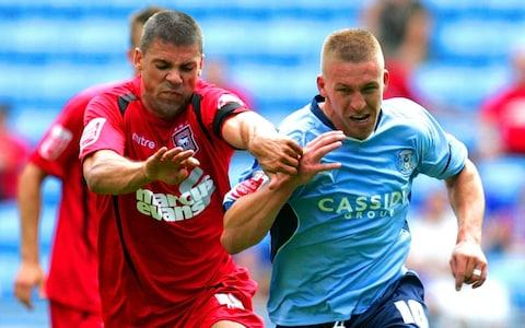 Freddy Eastwood of Coventry City and Jon Walters of Ipswich Town battle for the ball during the Coca-Cola Championship match between Coventry City and Ipswich Town - Credit: Tom Dulat/Getty Images