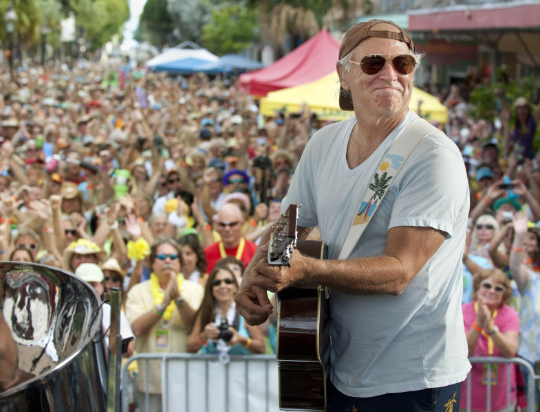 FILE - In this Friday, Nov. 4, 2011 photo provided by the Florida Keys News Bureau, singer/songwriter Jimmy Buffett performs before some 3,500 of his fans on Duval Street in Key West, Fla. Aerosmith, James Taylor, and Jimmy Buffett are among the scheduled performers for a Boston Marathon benefit concert May 30. The show, at the TD Garden, will benefit One Fund _ the collection of donations that will be distributed to the survivors of the April 15 bombings and the families of those killed in the attack. (AP Photo/Florida Keys News Bureau, Rob O'Neal)