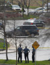 Kansas State Troopers stand outside a police line near the location of a shooting at the Jewish Community Center in Overland Park, Kan., Sunday, April 13, 2014. (AP Photo/Orlin Wagner)