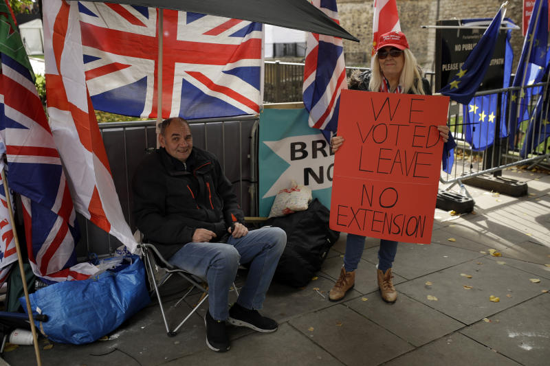 Brexit supporters in favour of leaving the European Union protest opposite the Houses of Parliament in London, Wednesday, Oct. 15, 2019. The European Union and Britain sought to keep their chances of reaching a full Brexit divorce deal by Thursday's EU summit alive on Wednesday despite legal issues centering on the Irish border frustrating negotiators. (AP Photo/Matt Dunham)
