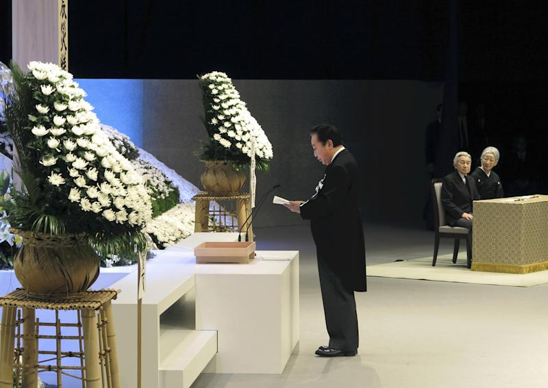 Japanese Prime Minister Yoshihiko Noda, left, gives a memorial address as Emperor Akihito, second right, and Empress Michiko, right, listen to him during the national memorial service for the victims of the March 11, 2011, earthquake and tsunami in Tokyo Sunday, March 11, 2012. Through silence and prayers, people across Japan on Sunday remembered the massive disaster that struck the nation one year ago, killing just over 19,000 people and unleashing the world's worst nuclear crisis in a quarter century. (AP Photo/Japan POOL) JAPAN OUT