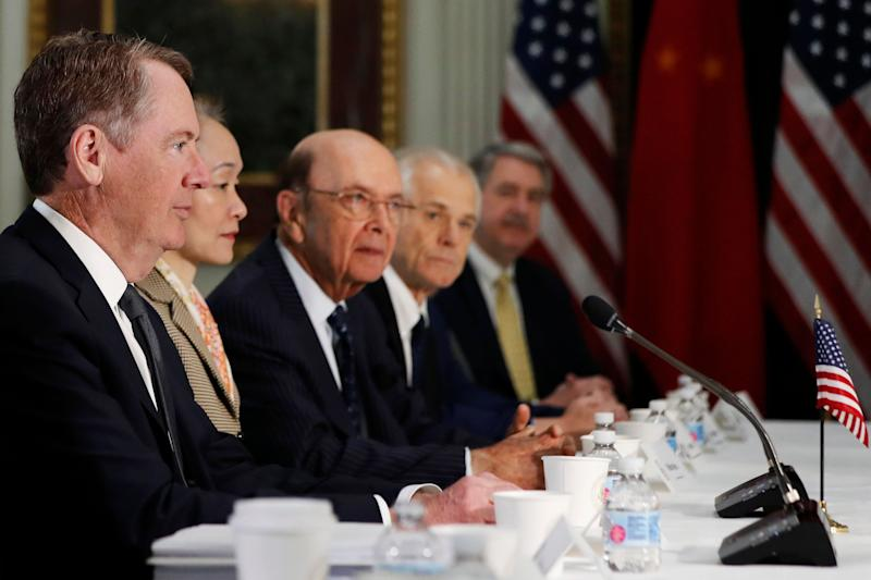 U.S. Trade Representative Robert Lighthizer, left, next to a translator, Commerce Secretary Wilbur Ross, and White House trade adviser Peter Navarro, attends a meeting of senior U.S. and Chinese officials to resume trade negotiations, Thursday, Feb. 21, 2019, in the Indian Treaty Room of the Eisenhower Executive Office Building at the White House complex, in Washington. (AP Photo/Jacquelyn Martin)