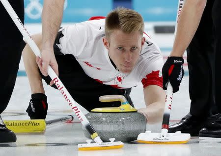 Curling - Pyeongchang 2018 Winter Olympics - Men's Bronze Medal Match - Switzerland v Canada - Gangneung Curling Center - Gangneung, South Korea - February 23, 2018 - Vice-skip Marc Kennedy of Canada delivers the stone. REUTERS/John Sibley