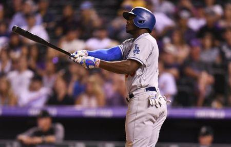 Los Angeles Dodgers right fielder Yasiel Puig follows through on his ninth-inning home run against the Colorado Rockies. (AP)