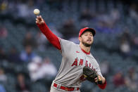 Los Angeles Angels starting pitcher Griffin Canning throws to first base to pick off Seattle Mariners' Jose Marmolejos during the fourth inning of a baseball game Saturday, May 1, 2021, in Seattle. (AP Photo/Elaine Thompson)