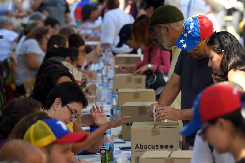 Venezuelans turned out to vote here in Barcelona, and in cities across Spain (AFP Photo/LLUIS GENE)