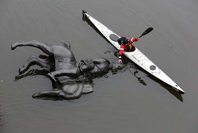 A replica equestrian statue of King Edward VII is nudged into position by Jon McCurley of art duo Life Of A Craphead, allowing it to float down the Don River during a performance in Toronto, Ontario, Canada October 29, 2017. REUTERS/Chris Helgren TPX IMAGES OF THE DAY