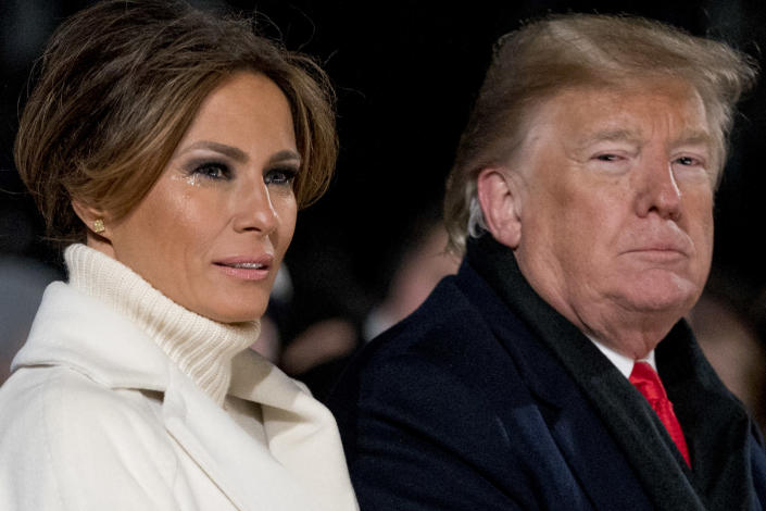 Melania Trump and President Trump attend a cold National Christmas Tree lighting ceremony at the Ellipse near the White House in Washington on Wednesday. (Photo: Andrew Harnik/AP)