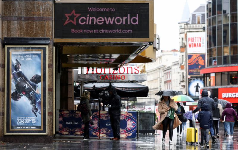 FILE PHOTO: People walk past a Cineworld in Leicester's Square in London