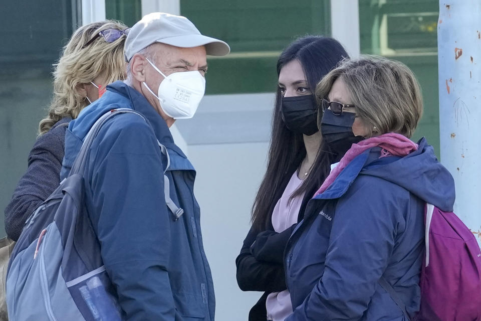 The family of slain Italian doctoral student Giulio Regeni, from right, mother Paola Deffendi, Giulio's sister Irene, and father Claudio Regeni arrive arrive with their lawyer Alessandra Ballerini, left, at the Rebibbia prison in Rome, Thursday, Oct. 14, 2021, to attend the first hearing of the trial for the death of Italian doctoral student Giulio Regeni, who disappeared for several days in January 2016 before his body was found on a desert highway north of the Egyptian capital. Italian prosecutors have formally put four high-ranking members of Egypt's security forces under investigation for their alleged roles in the slaying. (AP Photo/Andrew Medichini)