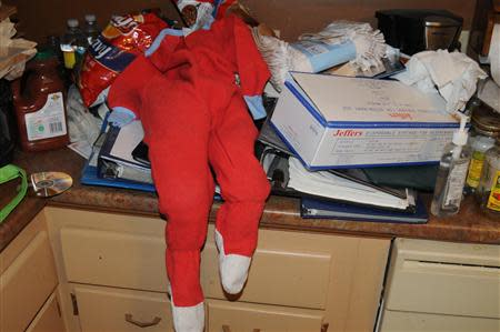 A set of child's pajamas and a box of syringes are shown in a US Attorney's Office handout photo
