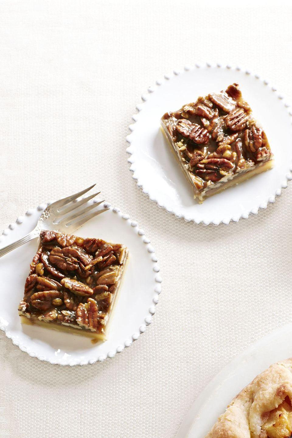 "<p>Pecan pie has a whole new look — but the same quintessential (and delicious) flavor. </p><p><em><a href=""https://www.goodhousekeeping.com/food-recipes/a14469/pecan-squares-recipe-ghk1113/"" rel=""nofollow noopener"" target=""_blank"" data-ylk=""slk:Get the recipe for Pecan Squares »"" class=""link rapid-noclick-resp"">Get the recipe for Pecan Squares »</a></em></p><p><strong>RELATED: </strong><a href=""https://www.goodhousekeeping.com/food-recipes/dessert/g3611/best-pecan-pie-recipes/"" rel=""nofollow noopener"" target=""_blank"" data-ylk=""slk:19 Incredibly Delicious Pecan Pie Recipes to Try"" class=""link rapid-noclick-resp"">19 Incredibly Delicious Pecan Pie Recipes to Try</a></p>"