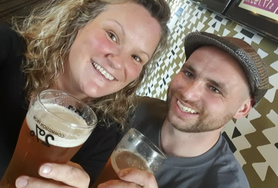 Connor Reed, right, is seen holding a beer while smiling with his mum, Hayley.