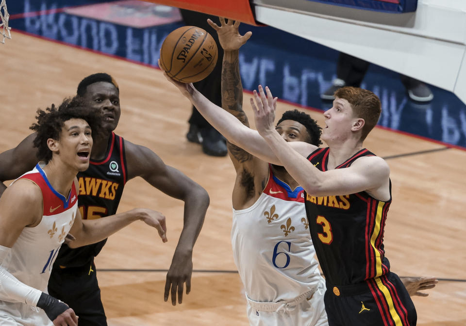 New Orleans Pelicans guard Nickeil Alexander-Walker (6) blocks a shot-attempt by Atlanta Hawks guard Kevin Huerter (3) in the second quarter of an NBA basketball game in New Orleans, Friday, April 2, 2021. (AP Photo/Derick Hingle)