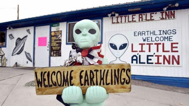 PHOTO: An alien-like statue displays a sign welcoming guests to the Little A'le' Inn restaurant and gift shop, July 22, 2019, in Rachel, Nevada. (David Becker/Getty Images, FILE)