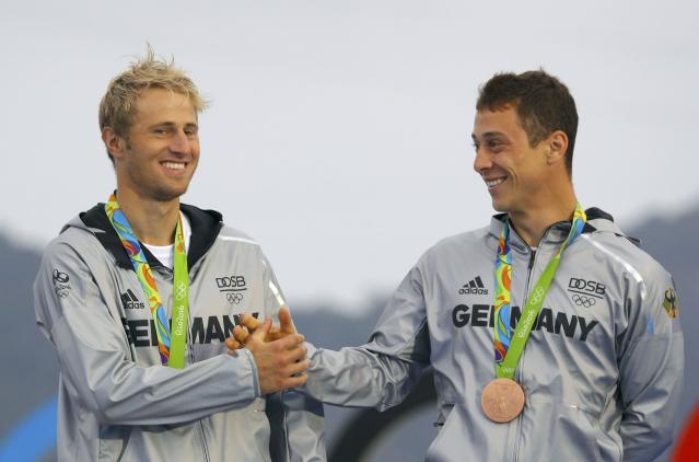 2016 Rio Olympics - Sailing - Victory Ceremony - Men's Skiff - 49er Victory Ceremony - Marina de Gloria - Rio de Janeiro, Brazil -18/08/2016. Erik Heil (GER) of Germany and Thomas Ploessel (GER) of Germany pose with their bronze medals. REUTERS/Brian Snyder FOR EDITORIAL USE ONLY. NOT FOR SALE FOR MARKETING OR ADVERTISING CAMPAIGNS.