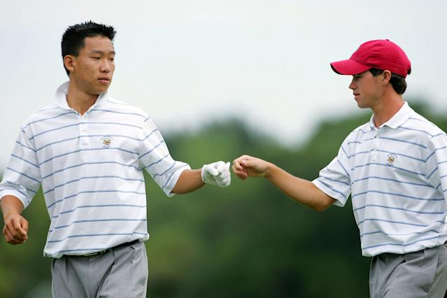 """<div class=""""caption""""> Kim and Harman knock fists during their Sunday morning foursomes match at the 2005 Walker Cup at Chicago Golf Club. </div> <cite class=""""credit"""">Jamie Squire</cite>"""