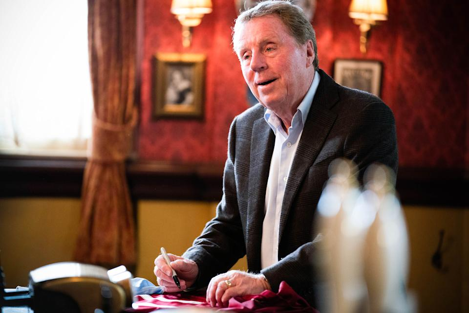 Harry Redknapp signs Mick Carter's shirt in the Queen Vic. (BBC)